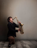 Young musician playing on saxophone Royalty Free Stock Photo