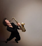 Young musician playing on saxophone Royalty Free Stock Photography