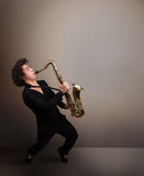 Young musician playing on saxophone Stock Photography
