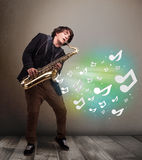 Young musician playing on saxophone while musical notes explodin Royalty Free Stock Image