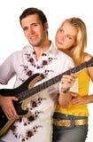 Young musician plays guitar Stock Photography