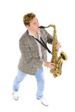 Young musician plays the saxophone. Stock Photos
