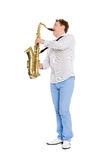 Young musician plays the saxophone Royalty Free Stock Photo