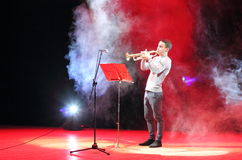 Young musician plays the trumpet Royalty Free Stock Images