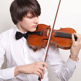 A young musician plays the violin Stock Photography