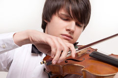 A young musician plays the violin Royalty Free Stock Image