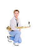 Young musician with saxophone Stock Image
