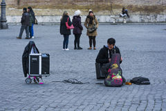Young musician in the square of the people as he prepares for the exhibition Stock Image