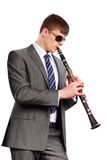 Young musician with sunglasses playing the clarine Royalty Free Stock Photography