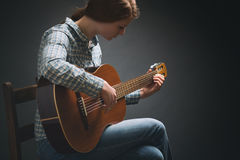 Young Musician - Woman with Guitar Royalty Free Stock Photography