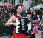 Young Woman Playing an Accordion  Stock Photo