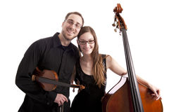 Young musicians with bass and violin Royalty Free Stock Photography