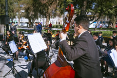 Young musicians. Melipilla, Chile. July 27, 2017.  Municipal musicians group in public presentation in the square of the Melipilla city , Chile. Young musicians Royalty Free Stock Photo