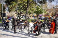 Young musicians. Melipilla, Chile. July 27, 2017.  Municipal musicians group in public presentation in the square of the Melipilla city , Chile. Young musicians Royalty Free Stock Photography