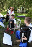 Young musicians of the orchestra of Ukrainian folk instruments playing music in national costumes. Royalty Free Stock Images