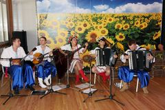 Young musicians of the orchestra of Ukrainian folk instruments playing music in national ukrainian costumes. Royalty Free Stock Photos