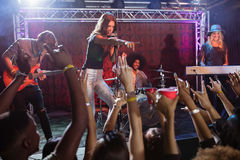 Young musicians performing on stage during music festival. At nightclub Stock Image