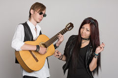 Young Musicians Play And Sing On Guitar Royalty Free Stock Photography