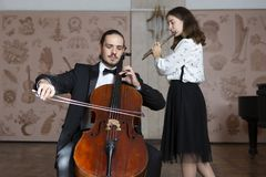 Young musicians of the symphony orchestra Duet stock photography