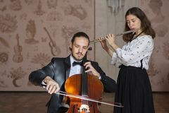 Young musicians of the symphony orchestra Duet royalty free stock image