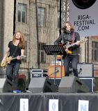 Young musicians on 75th Anniversary of John Lennon festival in Riga. Young musicians playing music on Tribute festival 75th Anniversary of John Lennon in Riga stock photography