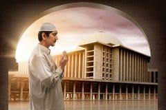 Young muslim asian man praying to god Stock Photos