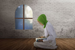 Young muslim asian woman reading the quran Stock Photo