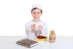 Young Muslim boy praying in Ramadan Royalty Free Stock Images