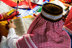 A Young Muslim Boy reading. Royalty Free Stock Image