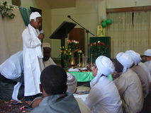 A young Muslim boy recites a poem  in Maulid Stock Photo