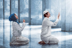 Young muslim couple praying Stock Photo