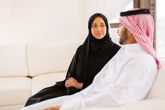 Young muslim couple sitting royalty free stock photography