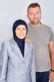 Young muslim couple standing isolated studio stock image
