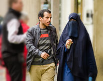 Young Muslim couple walking in Old Prague. Prague, Czech Republic - September 26, 2014: Young Muslim couple walks down the street of Old Town. Woman wears Stock Photography