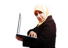 Young muslim female in traditional clothes with la. The Young muslim female in traditional clothes with laptop Royalty Free Stock Images