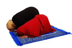 Young muslim female in traditional clothes praying Royalty Free Stock Photo