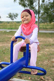 Young Muslim Girl. Was playing in playground field Royalty Free Stock Photo