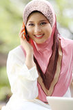 Young muslim girl. With cellphone royalty free stock photo