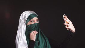 Young Muslim Girl in Hijab Doing Selfie on Mobile Phone Camera. Young Muslim Girl in Hijab Doing Selfie on Mobile Phone Camera stock video