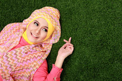 Young muslim girl lying on grass Stock Images