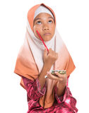 Young Muslim Girl With Pencil and Notepad III Stock Images