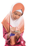 Young Muslim Girl With Pencil and Notepad IV Royalty Free Stock Photography