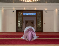 Young muslim girl pray in mosque Stock Images
