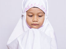 Young muslim girl praying Royalty Free Stock Images