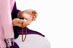 Young muslim girl praying. Young muslim girl with rosary praying on white background Stock Photography