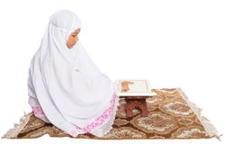 Young Muslim Girl Reading Al Quran IV Stock Image