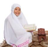 Young Muslim Girl Reading Al Quran VI Stock Images