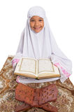 Young Muslim Girl Reading Al Quran VII Stock Photography