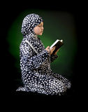 Young Muslim Girl Reading Holy Book of Quran Royalty Free Stock Images