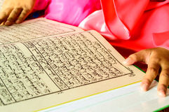 A Young Muslim Girl reading. Stock Image
